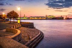 Evening over the town. Pink evening over the Neva River and the view of Vasilyevsky Island Royalty Free Stock Photos