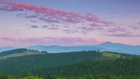 Evening over the Ukrainian Carpathians. Time Lapse. Summer Ukrainian Carpathians. Low mountains, forests and clouds. The colors of sunset. Time lapse stock video