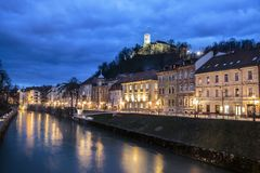 Evening panorama of riverfront of Ljubljana, Slovenia. Evening panorama of Ljubljana riverfront, architecture and castle, capital of Slovenia Royalty Free Stock Photos