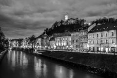 Evening panorama of riverfront of Ljubljana, Slovenia. Evening panorama of Ljubljana riverfront, architecture and castle, capital of Slovenia. Black and white Royalty Free Stock Images