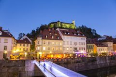 Evening panorama of riverfront of Ljubljana, Slovenia. Evening panorama of Ljubljana riverfront, architecture and castle, capital of Slovenia Stock Photography