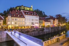 Evening panorama of riverfront of Ljubljana, Slovenia. Evening panorama of Ljubljana riverfront, architecture and castle, capital of Slovenia Royalty Free Stock Images