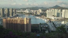 Evening panorama of Sanya from the top of a hill in a Luhuitou Park stock footage video. Sanya, China - April 07, 2017: Evening panorama of Sanya from the top of stock footage
