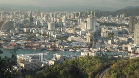 Evening panorama of Sanya from the top of a hill in a Luhuitou Park stock footage video stock footage