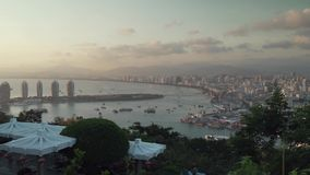 Evening panorama of Sanya from the top of a hill in a Luhuitou Park stock footage video stock video footage