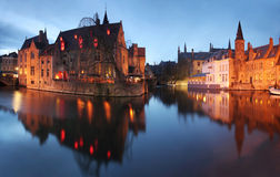Evening panorama of some of the famous icons from Brugge (Bruges) city, Belgium Stock Photos