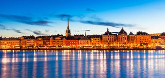Evening panorama of Stockholm, Sweden. Beautiful evening scenic panorama of the Old Town (Gamla Stan) pier architecture in Stockholm, Sweden Stock Photo