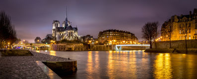 Evening panoramic of Notre Dame de Paris Cathedral on Ile de La Cite with the Seine River. France. Evening panoramic view of Notre Dame de Paris Cathedral on Ile Stock Images