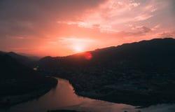 Evening panoramic view of Mtskheta city and Kura river from Jvari monastery at sunset. Georgia Royalty Free Stock Photography