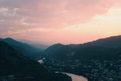 Evening panoramic view of Mtskheta city and Kura river from Jvari monastery at sunset. Georgia Royalty Free Stock Photo