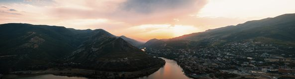 Evening panoramic view of Mtskheta city and Kura river from Jvari monastery at sunset. Georgia Stock Images