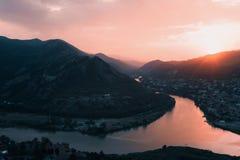 Evening panoramic view of Mtskheta city and Kura river from Jvari monastery at sunset. Georgia Stock Photography
