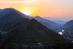 Evening panoramic view of Mtskheta city and Kura river from Jvari monastery at sunset. Georgia. Europe Royalty Free Stock Images