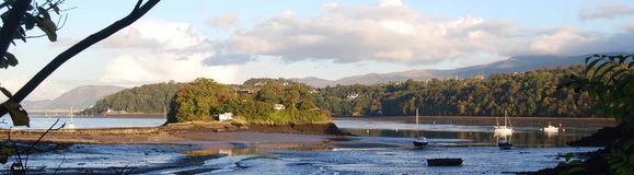 Evening peace Menai Strait Wales. Boats at anchor in Menai Strait, Welsh hills behind Stock Images