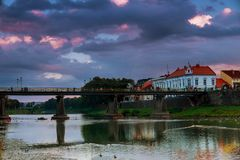 Evening pedestrian bridge in the center of Uzhgorod in the sunset Ukraine. Pedestrian bridge across the river in the center of Uzhgorod in the sunset evening Royalty Free Stock Photo