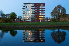 Evening photo of building located on the canal in Hoogeveen Royalty Free Stock Images