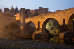 Evening photo of medieval bridge over river. Besalu Royalty Free Stock Photography