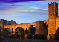Evening photo of medieval bridge over river. Besalu Royalty Free Stock Images