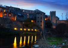 Evening photo of medieval town on banks of river. Besalu Royalty Free Stock Images