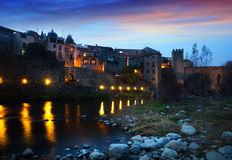 Evening photo of medieval town with bridge. Besalu Royalty Free Stock Photo