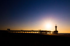 Evening pier silhouette. Evening silhouette of the pier of Scheveningen, the Netherlands Royalty Free Stock Images