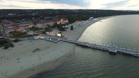 The evening pier in Sopot with a bird`s eye view, Poland, City Sopot, Poland, 07 2016, AERIAL FOOTAGE. The evening pier in Sopot with a bird`s eye view, Poland stock video footage