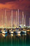 Evening port. Ships, boats and yachts in harbor Royalty Free Stock Photo