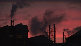 Evening at power station smoke comes out of chimney. Power station in the evening as smoke goes into the sky stock video footage