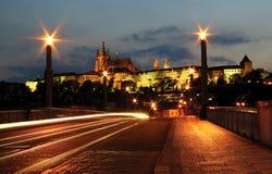 Evening Prague #2. View on bridge over the Vltava river and famous Castle illuminated at evening in Prague, Czech Republic Stock Image