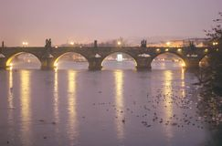 Evening in prague charles bridge lights on water royalty free stock images