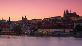 Evening in Prague on Vltava River. Time Lapse 4K. Czech Republic. Prague. Evening. View of the Vltava river with pleasure boats and city in background the stock video