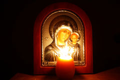 Evening Prayer of the Blessed Virgin Mary. The Lord looked at the flame of a candle, and the Virgin thought about Stock Photography