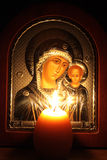 Evening Prayer of the Blessed Virgin Mary. The Lord looked at the flame of a candle, and the Virgin thought about Royalty Free Stock Photo