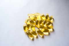 Evening primrose oil supplement capsules from above Stock Photos