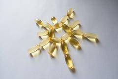 Evening primrose oil supplement capsules arranged as sun Stock Images