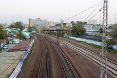 Evening railway track curve in city Stock Photos