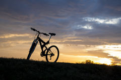 Evening recreation with bicycle. With sunset and dramatic sky Royalty Free Stock Photography