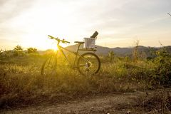 Evening recreation with bicycle with sunset and dramatic sky. Royalty Free Stock Images
