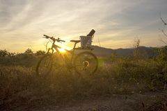Evening recreation with bicycle with sunset and dramatic sky. Royalty Free Stock Photos