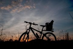 Evening recreation with bicycle with sunset and dramatic sky. Stock Image