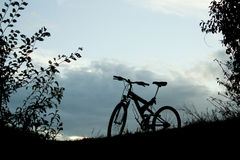 Evening recreation with bicycle. Take a break from riding mountain bikes in the sunset royalty free stock photography