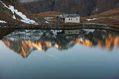 Evening reflection in the mountains stock images