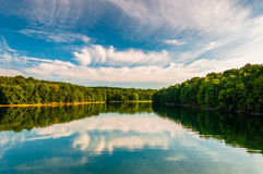 Evening reflections of clouds and trees in Lake Marburg, Codorus Royalty Free Stock Image