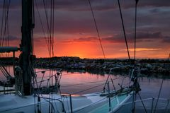 Evening relaxing time on sailing boat in the harbor Stock Photos