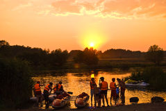 Evening on the river. Ukraine river South Bug threshold Red Gate is competitions on aquatics, catamarans, sportsmen, evening, sporting event, summer, sunset Royalty Free Stock Photos