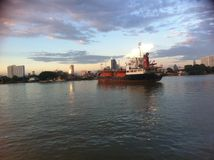Evening river and big ship Stock Photo