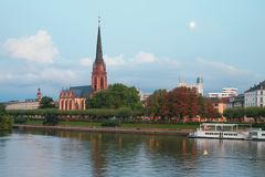 Evening river, embankment and church. Frankfurt am Main, Germany Royalty Free Stock Images