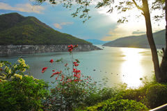 On evening at riverside in Bhumibol dam Royalty Free Stock Photo