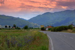 Evening road to mountains Royalty Free Stock Images