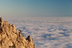 Evening rocks and sea in clouds Stock Photo